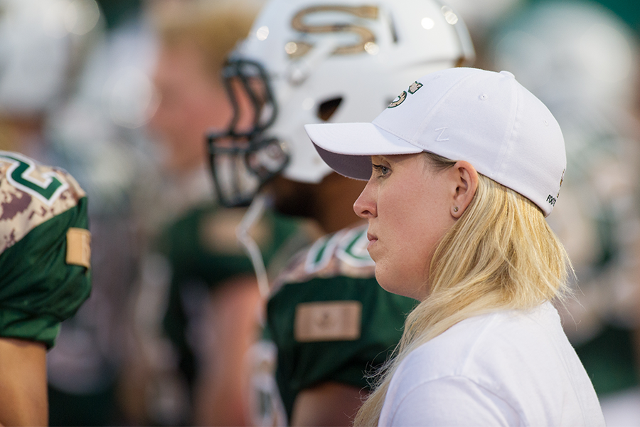 Andrea Eccleston, equipment manager for the Huskies football team