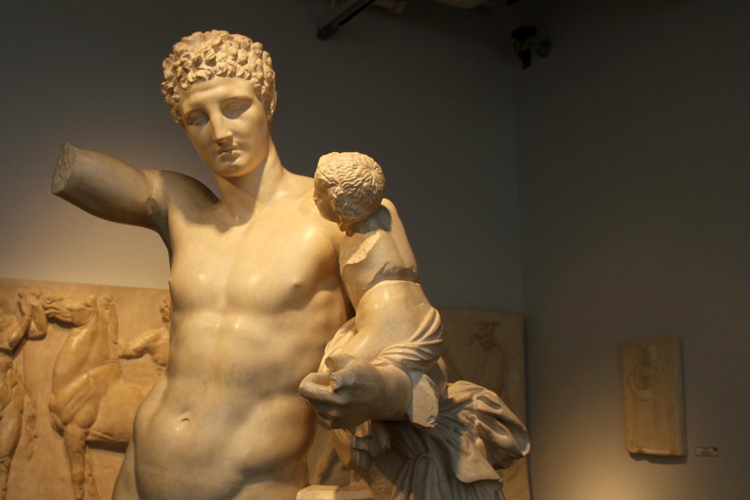 Hermes holds his younger brother Dionysus in the Museum of Antiquities