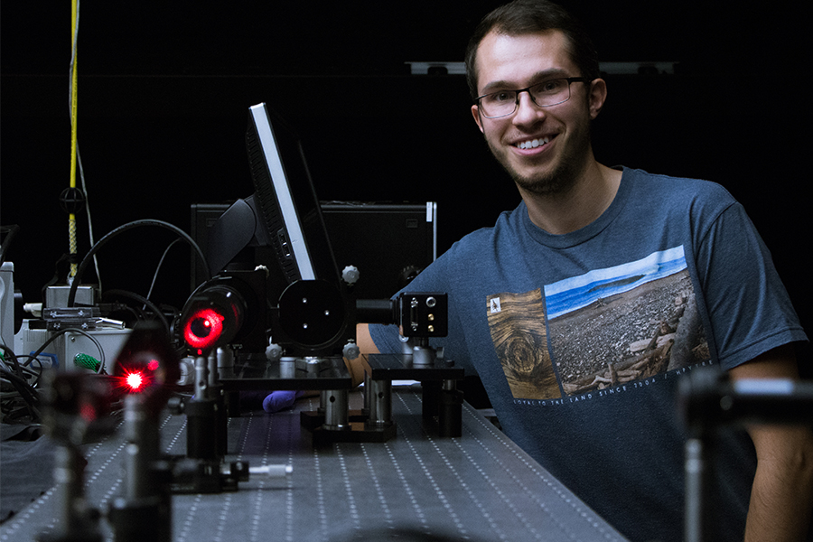 Matthew Kozun with the Aerosol Limb Imager in the Department of Physics and Engineering Physics optics lab