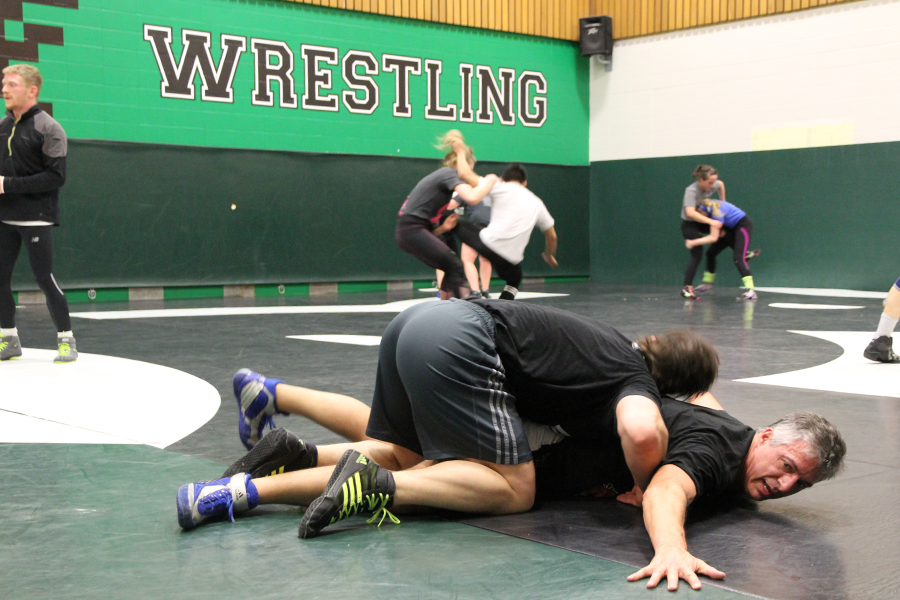 Michael Robin wrestles with the Huskies.