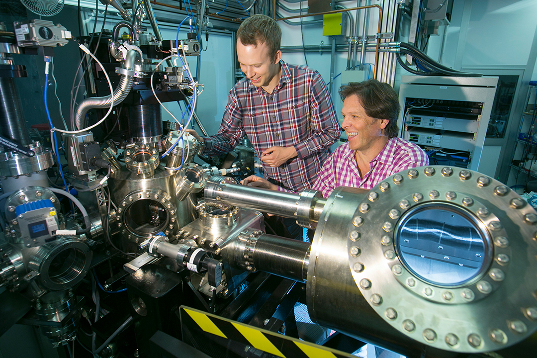 Neil Johnson (left) and his supervisor, Alexander Moewes, study a new super-thin material using synchrotron light (photo by David Stobbe).
