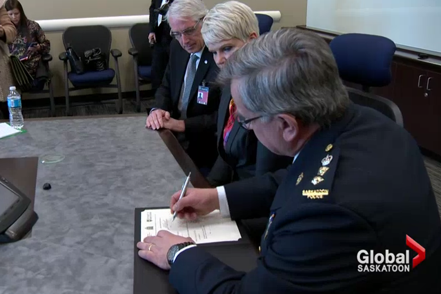 U of S President Peter Stoicheff, Minister Responsible for Corrections and Policing Christine Tell, and Saskatoon Police Deputy Chief Bernie Pannell at the launch of the Predictive Analytics Laboratory (screenshot from Global Saskatoon).