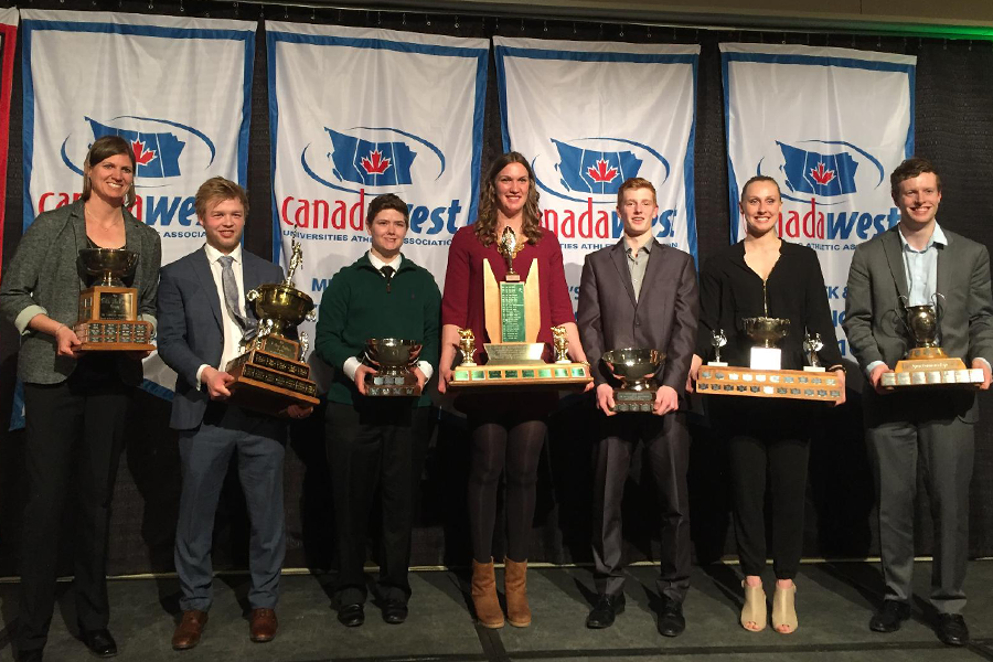 Jordan Cooke (second from left) and Laura Dally (second from right) were among those honoured at the annual Huskie Salute awards dinner.