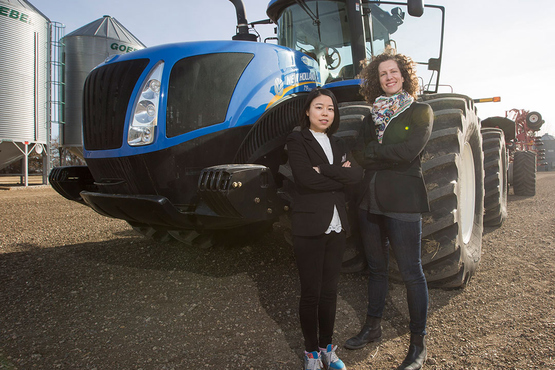 Catherine Trask (right) and Xiaoke Zeng study farmers' exposure to body vibrations (photo by David Stobbe).
